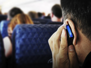 on-cell-phone-on-plane
