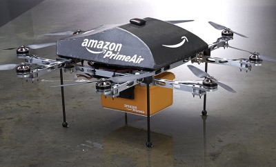"An Amazon PrimeAir drone is shown in this publicity photo released to Reuters on December 2, 2013. Amazon.com CEO Jeff Bezos told the CBS television program ""60 Minutes"" that the company is testing the use of delivery drones that could deliver packages that weigh up to five pounds (2.3 kg), which represents roughly 86 percent of packages that Amazon delivers, he said. REUTERS/Amazon.com/Handout via Reuters(UNITED STATES - Tags: BUSINESS SCIENCE TECHNOLOGY) ATTENTION EDITORS - THIS IMAGE WAS PROVIDED BY A THIRD PARTY. FOR EDITORIAL USE ONLY. NOT FOR SALE FOR MARKETING OR ADVERTISING CAMPAIGNS. NO SALES. NO ARCHIVES.THIS PICTURE IS DISTRIBUTED EXACTLY AS RECEIVED BY REUTERS, AS A SERVICE TO CLIENTS"